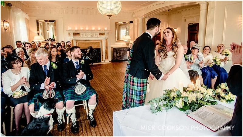 first kiss at eves hall winter wedding