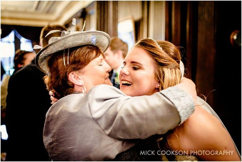 bride hugs her mum at eaves hall