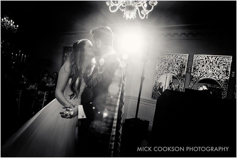 bride and groom first dance in black and white