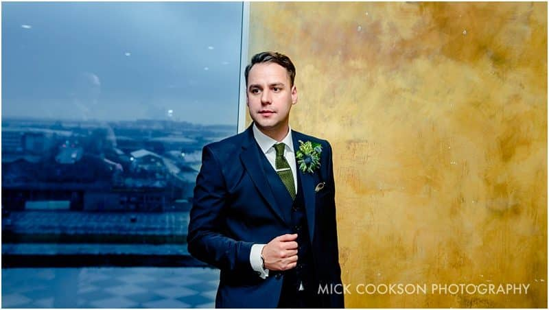 groom portrait at on the 7th