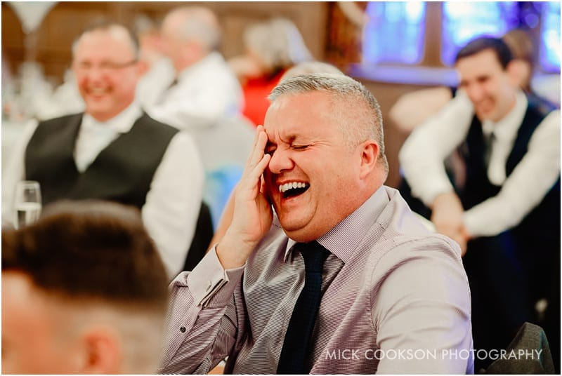 laughing wedding guest
