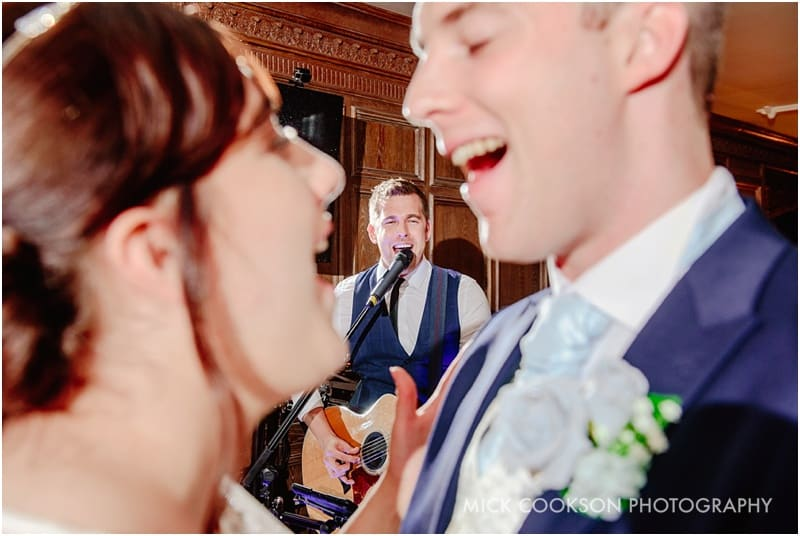 alex birtwell sings to the bride and groom at the royal toby hotel