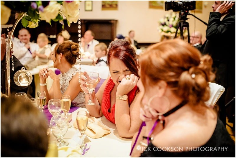 same sex wedding guests laughing