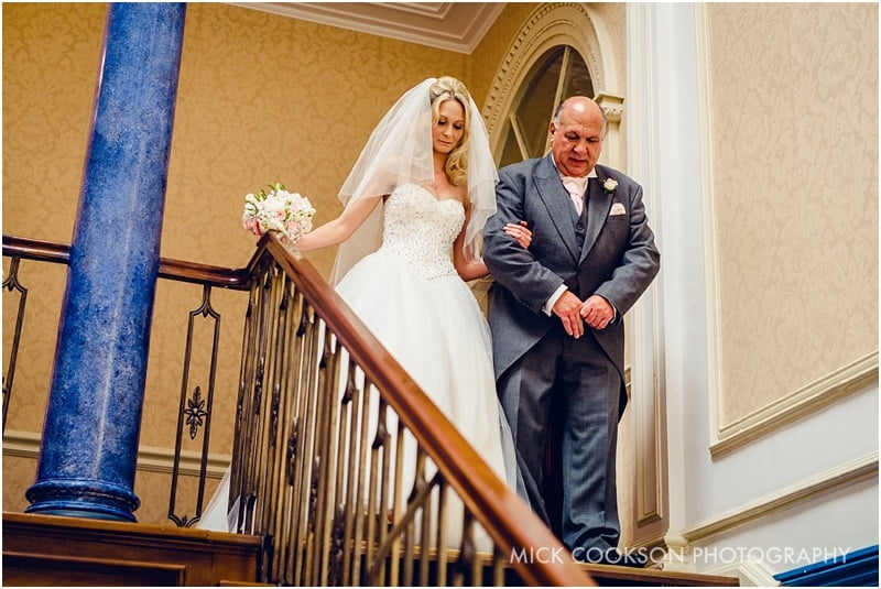bride and dad walking down stairs at shrigley hall