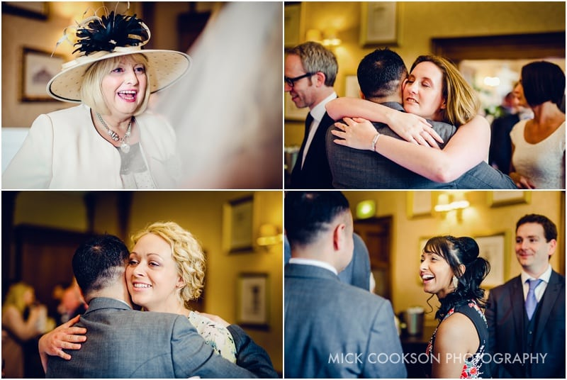 wedding guests hugging at shrigley hall