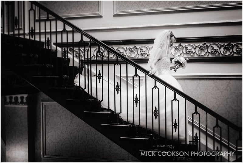 bride coming down shrigley hall stairs