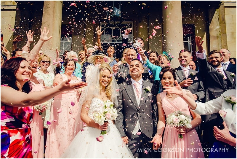 confetti being thrown at a shrigley hall wedding