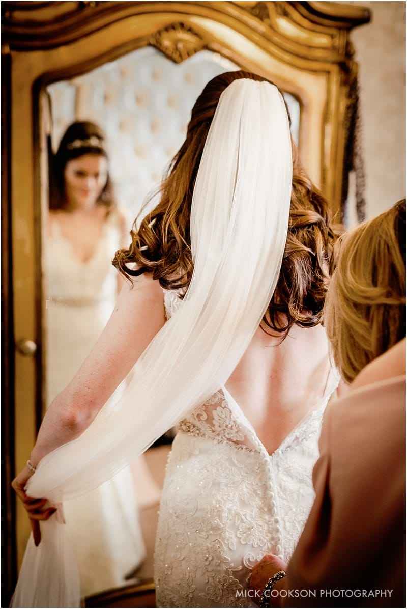 bride looking at herself in full length mirror
