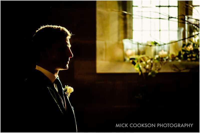 artistic photo of the groom
