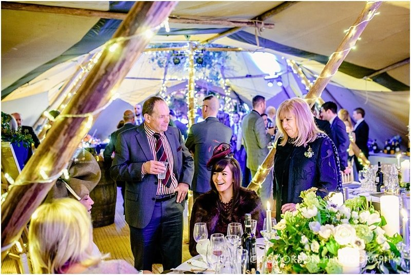 wedding guests inside a tipi
