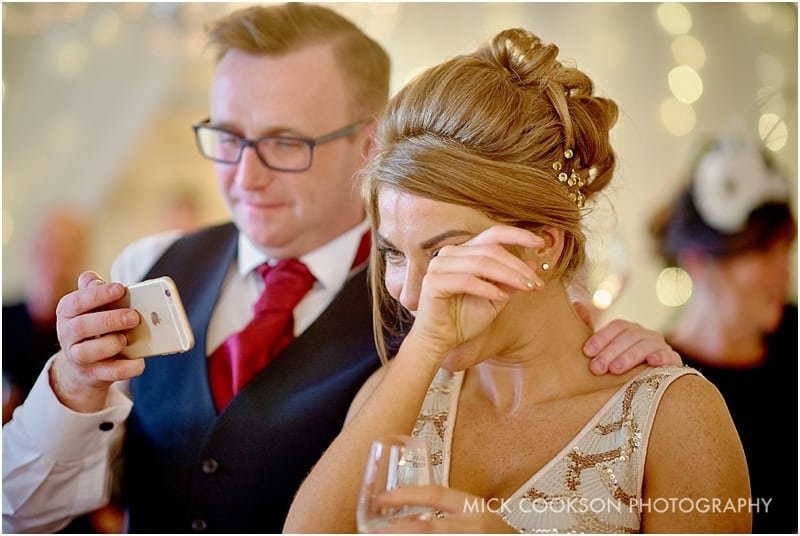 guest crying at emotional wedding speeches