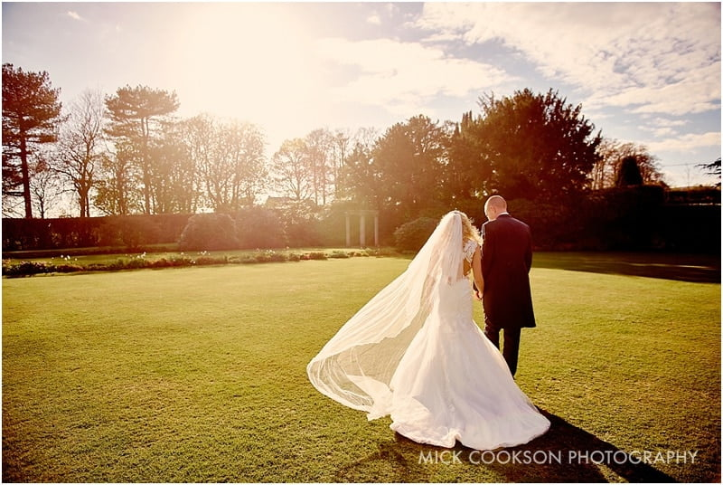 bride and groom photographed in an eaves hall sunset