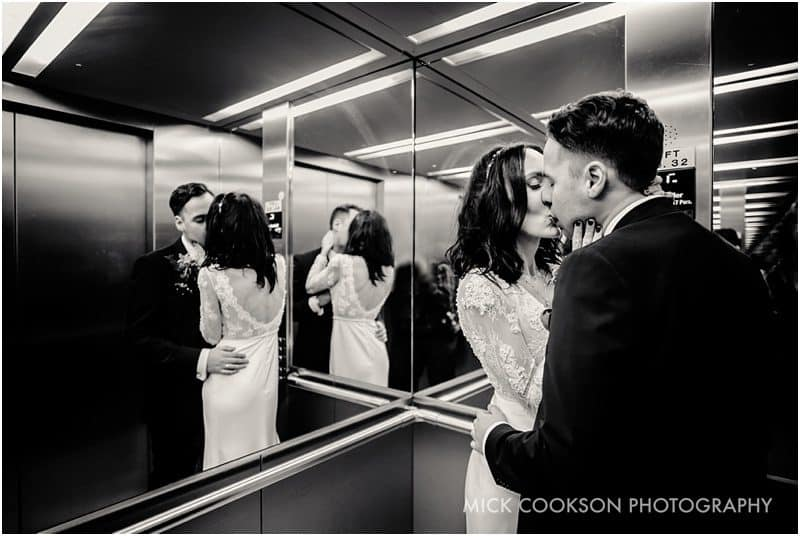bride and groom photo inside a lift