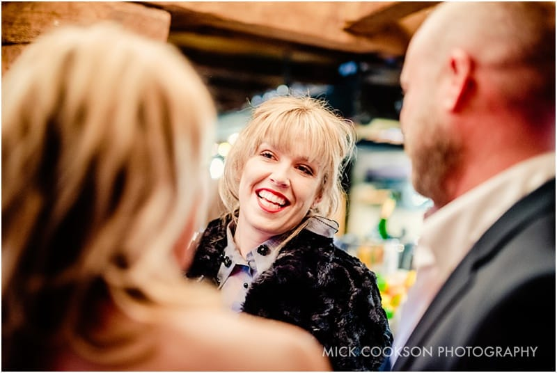 smiling wedding guest at the crazy bear stadhampton