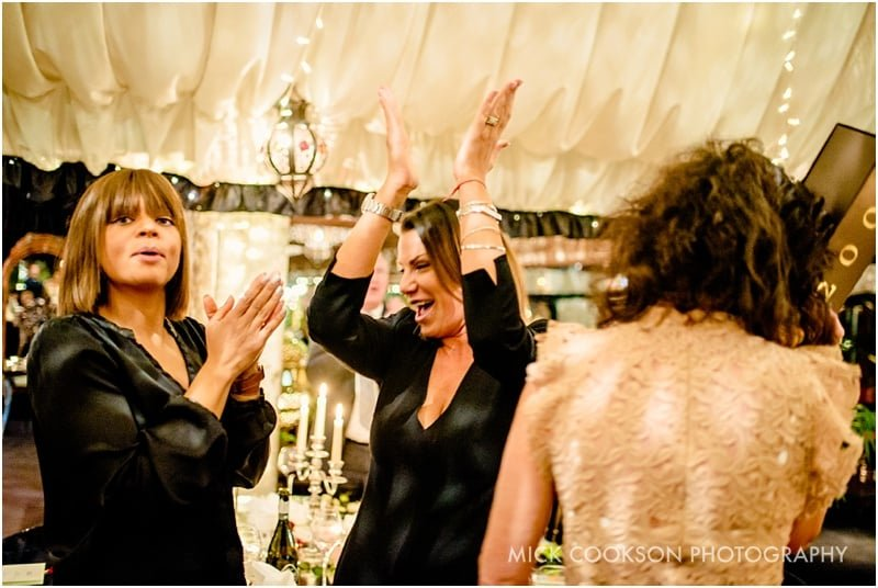 applaudong wedding guests at an oxford wedding