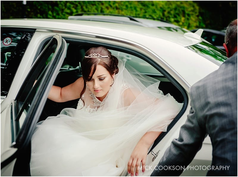 bride getting out of wedding car in middleton