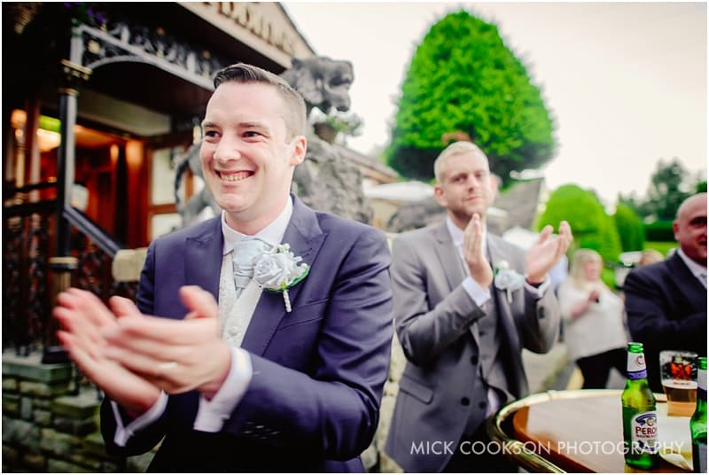 groom clapping