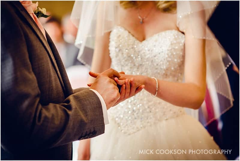 exchange of rings at a shrigley hall wedding