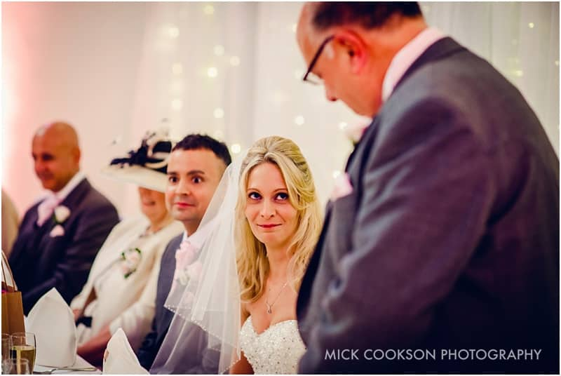 bride listening to her dad's speech