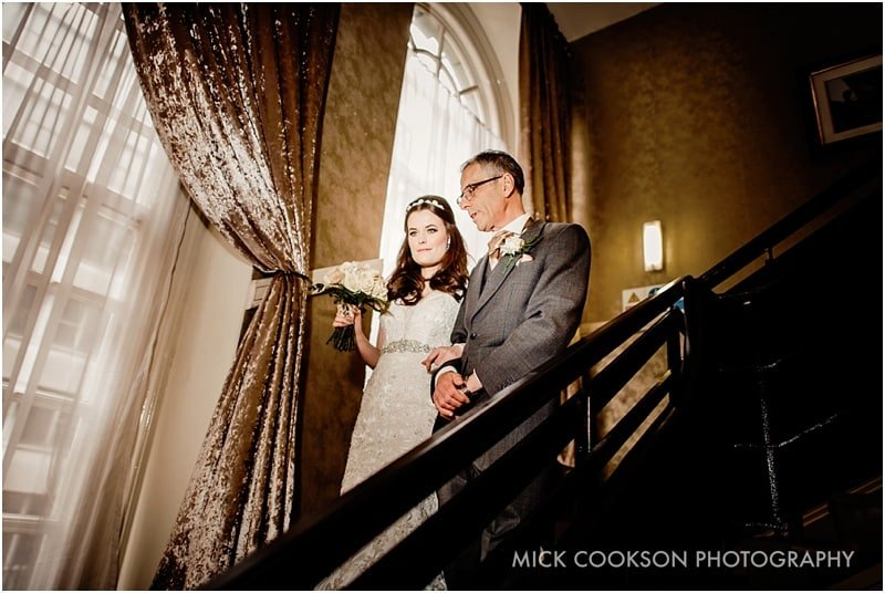 bride and her father on the stairs