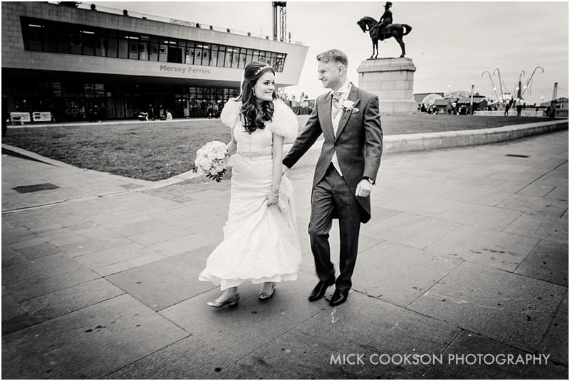 bride and groom at Pier Head in Liverpool