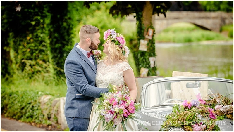 bride and groom embracing outside the spread eagle sawley