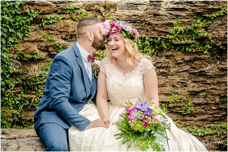 bride and groom laughing in lancashire