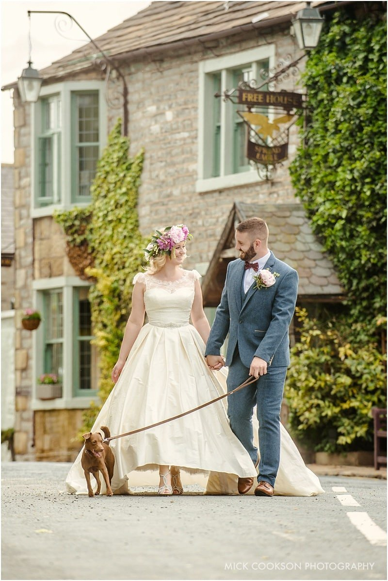 bride and groom with their dog at a wedding