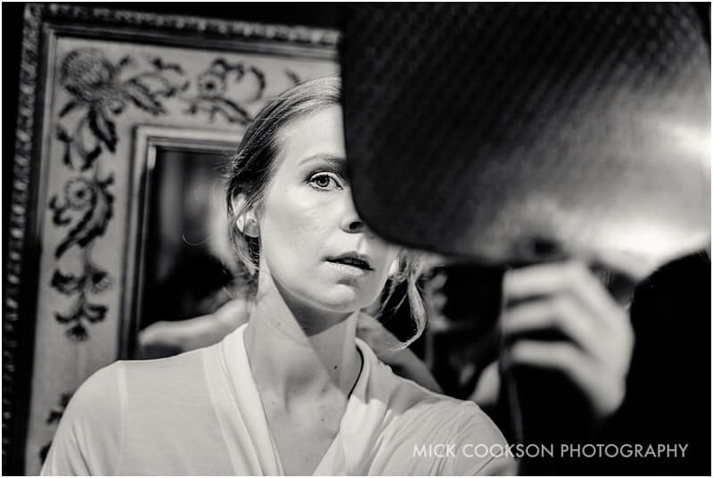 bride looking into a mirror