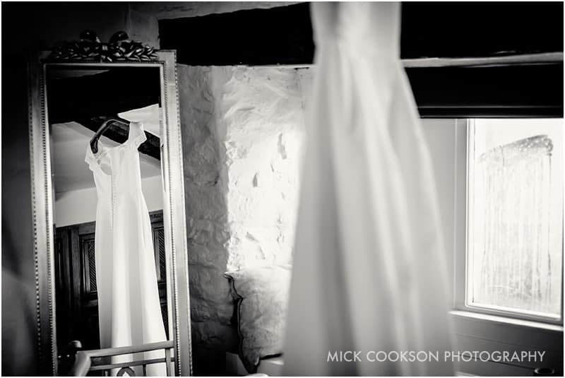 wedding dress hanging up at a farmhouse