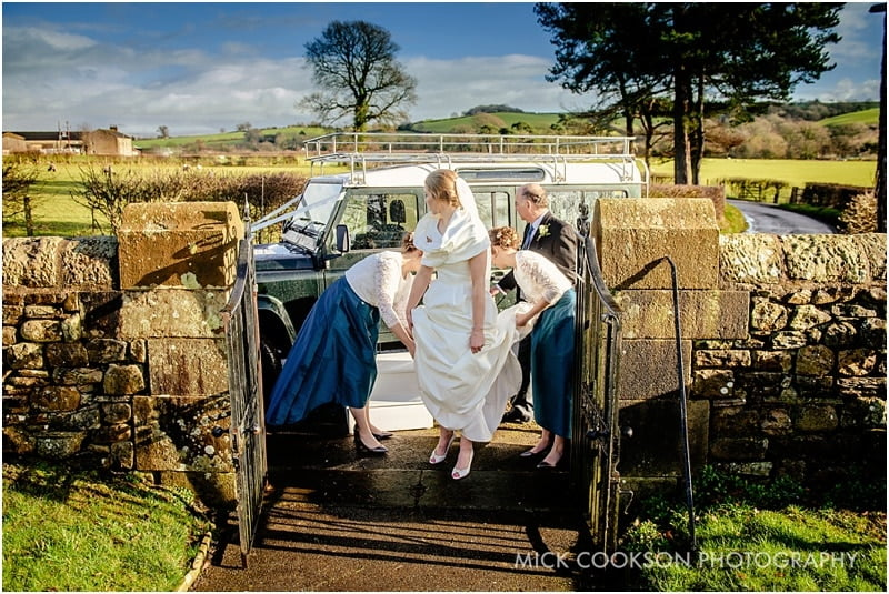 bride gets out of a land rover