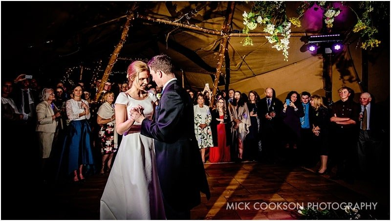 bride and groom dancing inside a tipi