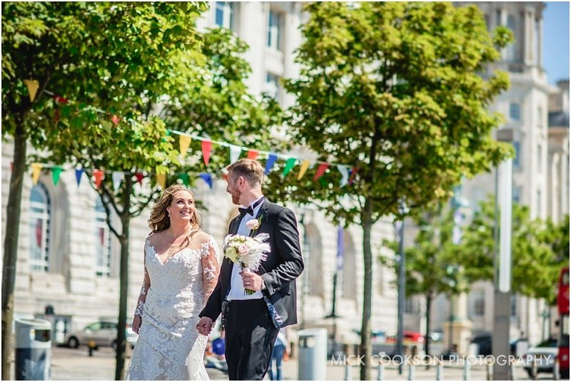wedding photo outside the liver building