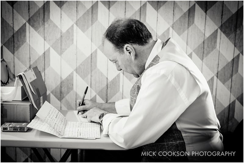 father of the bride writing his speech