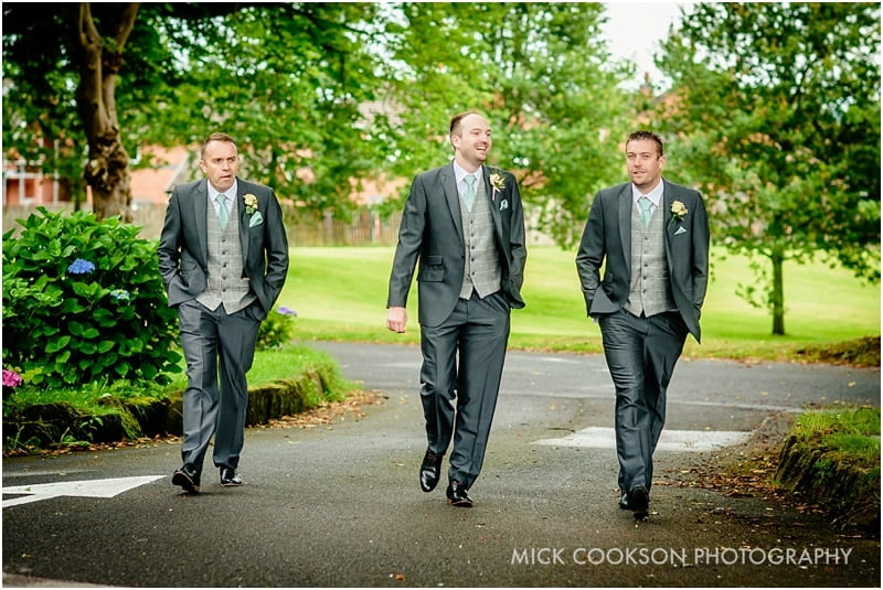 groomsmen arrive at church