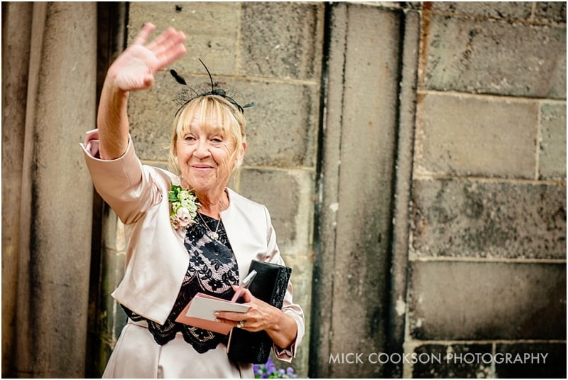 mum waving at wedding guests