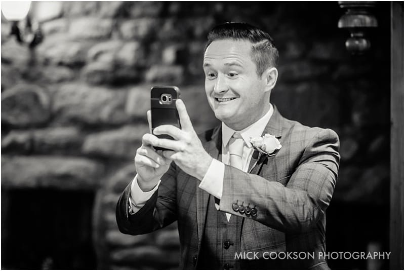 wedding guest takes a photo at beeston manor