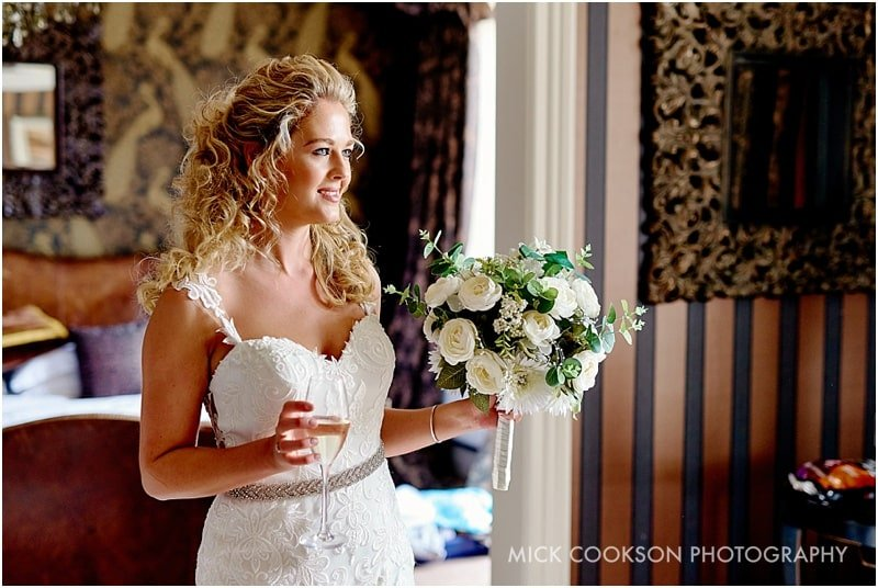 happy bride at eaves hall wedding