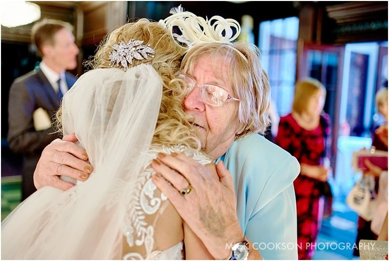 emotional gran hugging bride
