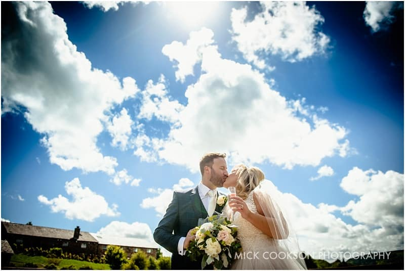 bride and groom against the sky