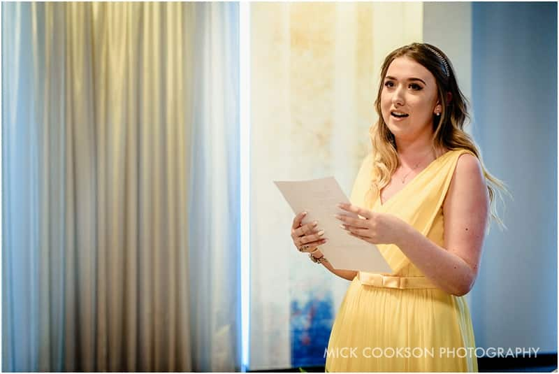 bridesmaid reads at a wedding