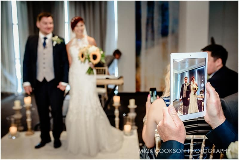 guest uses ipad at a wedding