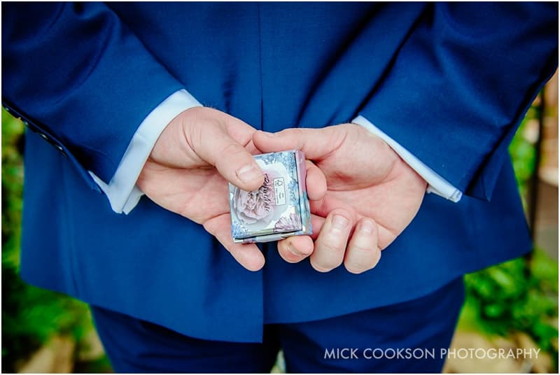 best man holding the rings
