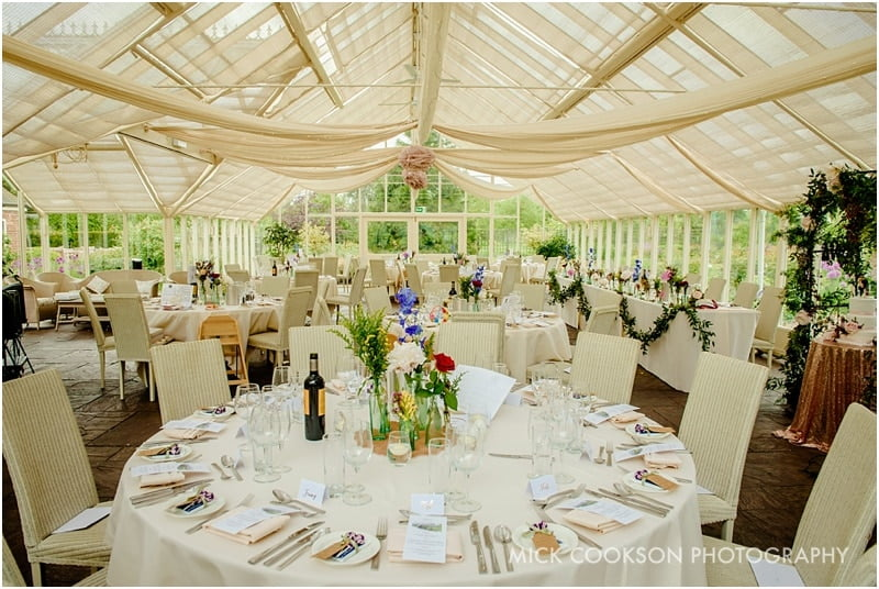 the glasshouse at abbeywood estate gardens set for a wedding
