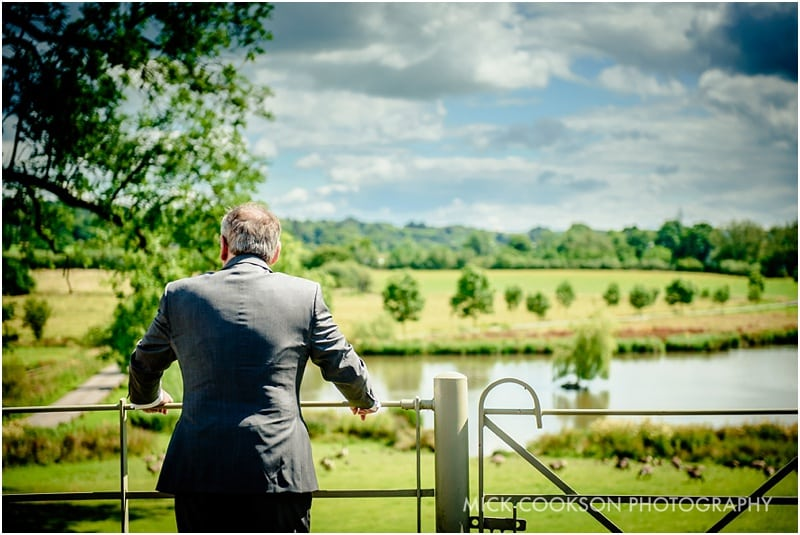 wedding guest looking at the lake