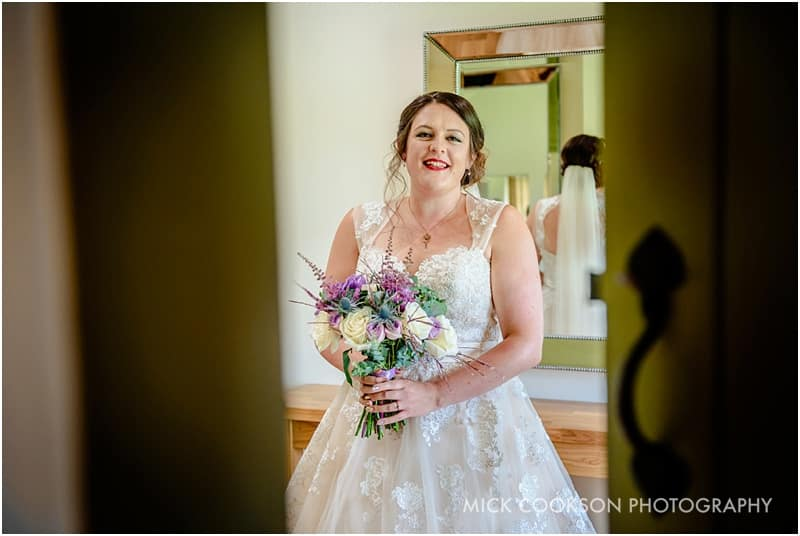 bride is ready to be married at the ashes barns wedding venue