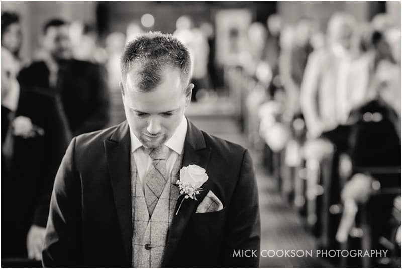 nervous groom in church