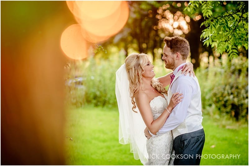 bride and groom photo under a tree at rivington hall barn