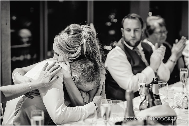 bride hugs her father at king street townhouse