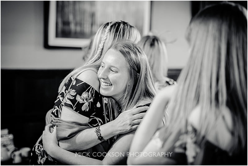 guests hugging at a shireburn arms wedding